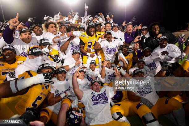The Mary HardinBaylor Cru celebrate after defeating the the Mountain Union Purple Raiders after the Division III Men's Football Championship held at...
