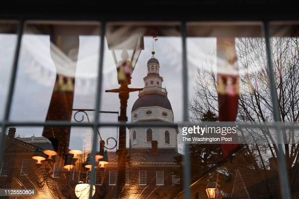 The Maryland State House is seen reflected in a window as the Maryland General Assembly convenes the 439th session on Wednesday January 09 2019 in...