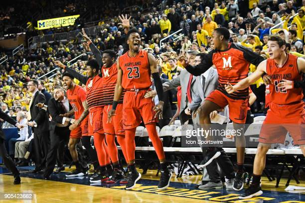 The Maryland Terrapins bench erupts following the shot to put them ahead 6766 with 32 seconds remaining during the Michigan Wolverines game versus...