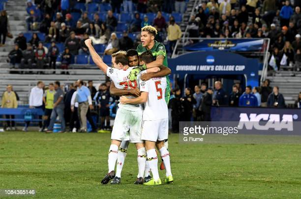 The Maryland Terrapins celebrate after defeating the Akron Zips during the Division I Men's Soccer Championship held at Meredith Field at Harder...