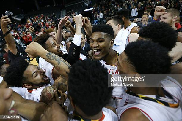 The Maryland Terrapins celebrate after defeating the Kansas State Wildcats 6968 during the championship game of the Barclays Center Classic at...
