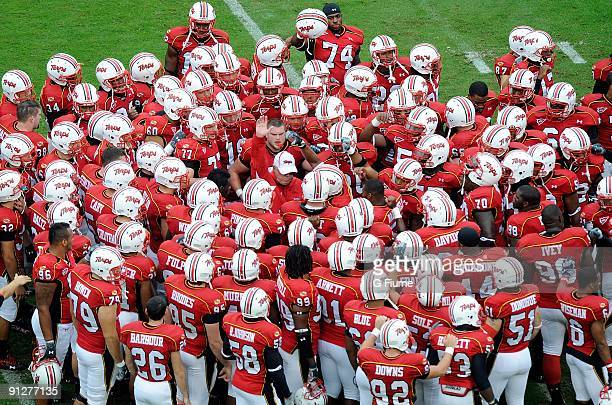 The Maryland Terrapins huddle around head coach Ralph Friedgen before the game against the Rutgers Scarlet Knights at Byrd Stadium on September 26,...