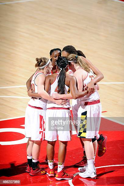 The Maryland Terrapins huddle up during the game against the Delaware State Hornets at the Comcast Center on December 14 2013 in College Park Maryland