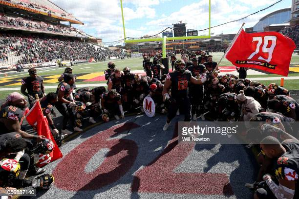 The Maryland Terrapins surround the to honor Jordan McNair prior to playing the Michigan State Spartans at Capital One Field on November 3 2018 in...