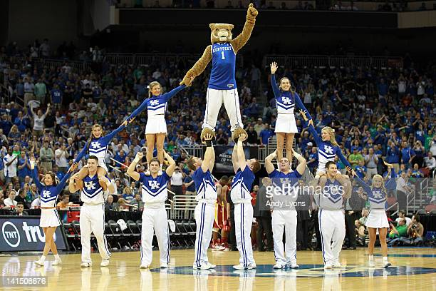 The mascot and cheerleaders for the Kentucky Wildcats perform a stunt against the Iowa State Cyclones during the third round of the 2012 NCAA Men's...