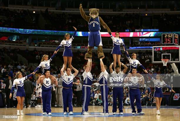 The mascot and cheerleaders from the Kentucky Wildcats perform a stunt during a timeout against the Kansas Jayhawks during the second round of the...