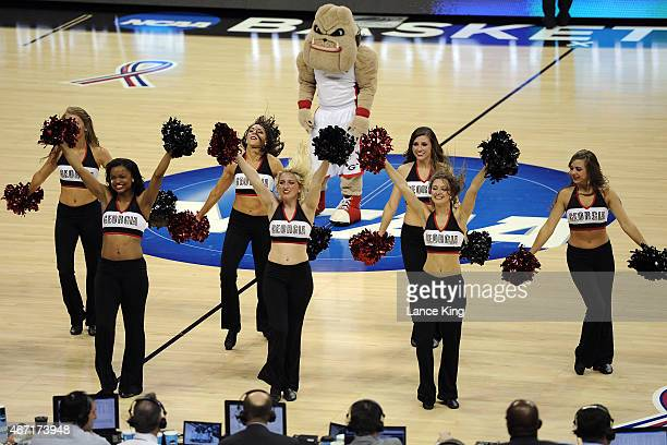 The mascot and cheerleaders of the Georgia Bulldogs perform against the Michigan State Spartans during the second round of the 2015 NCAA Men's...