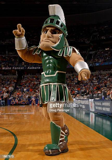The mascot for the Michigan State Spartans cheers for his team against the University of Florida Gators in the second round of the South Region of...