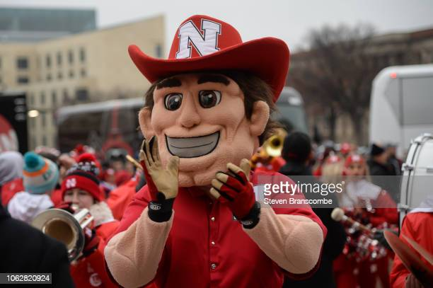 The mascot for the Nebraska Cornhuskers lead the team to the stadium before the game against the Michigan State Spartans at Memorial Stadium on...