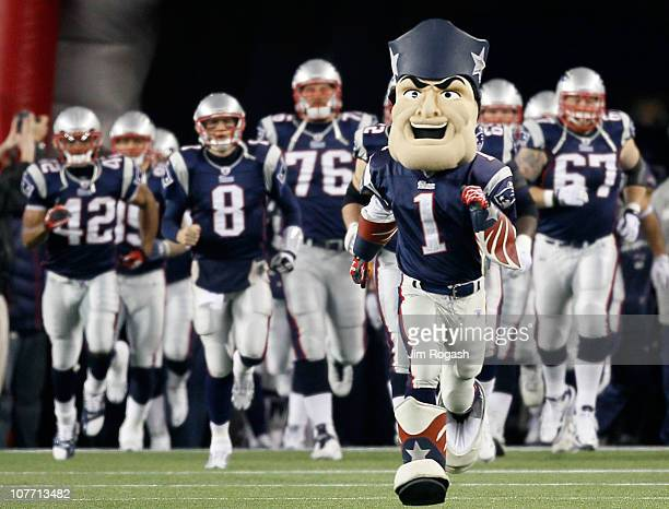 The mascot for the New England Patriots leads the team onto the feild before the game against the Green Bay Packers at Gillette Stadium on December...