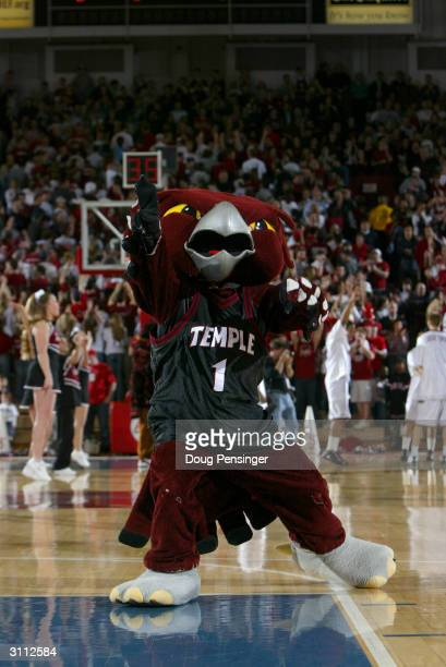 The mascot for the Temple University Owls entertains the crowd at the game against the Saint Joseph's University Hawks on February 21 2004 at The...