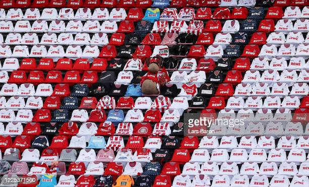 The mascot of 1. FC Koeln sits on the tribune with seats covered with team shirts ahead of the Bundesliga match between 1. FC Koeln and 1. FSV Mainz...