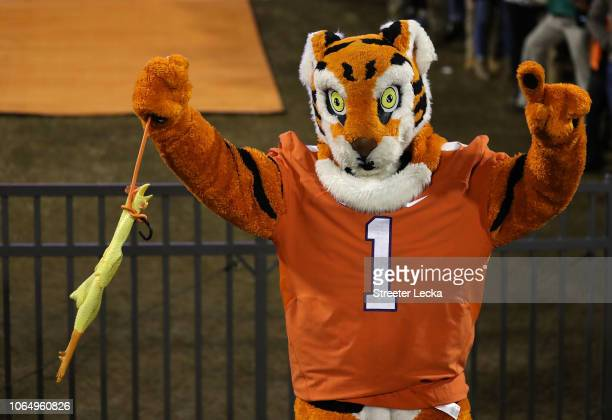 The mascot of the Clemson Tigers in action against the South Carolina Gamecocks during their game at Clemson Memorial Stadium on November 24 2018 in...