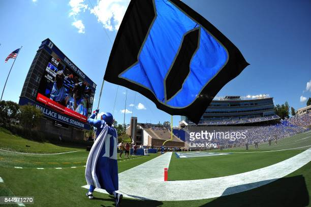 The mascot of the Duke Blue Devils runs with a flag during their game against the Northwestern Wildcats at Wallace Wade Stadium on September 9 2017...