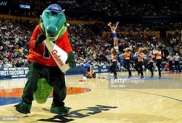 The mascot of the Florida Gators cheers during a stoppage in time against the Villanova Wildcats in the second round of the NCAA Division I Men's...