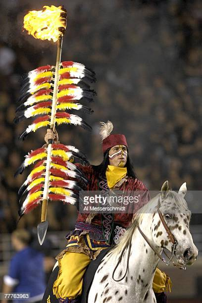 The mascot of the Florida State Seminoles carries a ligthted spear before play against the Duke Blue Devils at Doak Campbell Stadium on October 27...