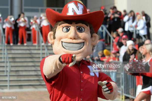 The mascot of the Nebraska Cornhuskers performs as the team arrives for the game against the Northwestern Wildcats at Memorial Stadium on November 4...