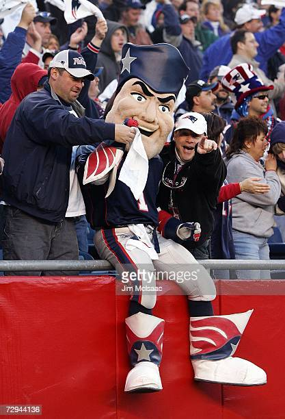 The mascot of the New England Patriots Pat Patriot celebrates with fans against the New York Jets in the AFC Wild Card Playoff Game at Gillette...