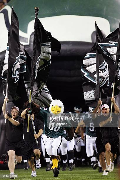 The mascot of the of the Philadelphia Eagles Swoop runs on the field before a game against the Green Bay Packers on October 2 2006 at Lincoln...
