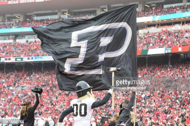 The mascot of the Purdue Boilermakers runs with the flag after a score against the Nebraska Cornhuskers at Memorial Stadium on September 29 2018 in...