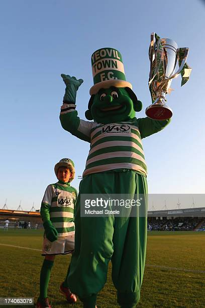 The mascot of Yeovil Town parades the Play Off Winners Trophy during the Pre Season friendly match between Yeovil Town and Swansea City at Huish Park...