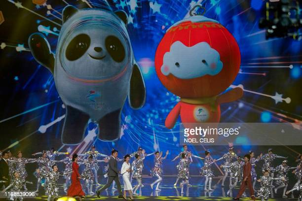 The mascots for the Beijing 2022 Winter Olympic 'Bing Dwen Dwen' and Paralympic Games 'Shuey Rhon Rhon' are projected to a screen on the stage during...