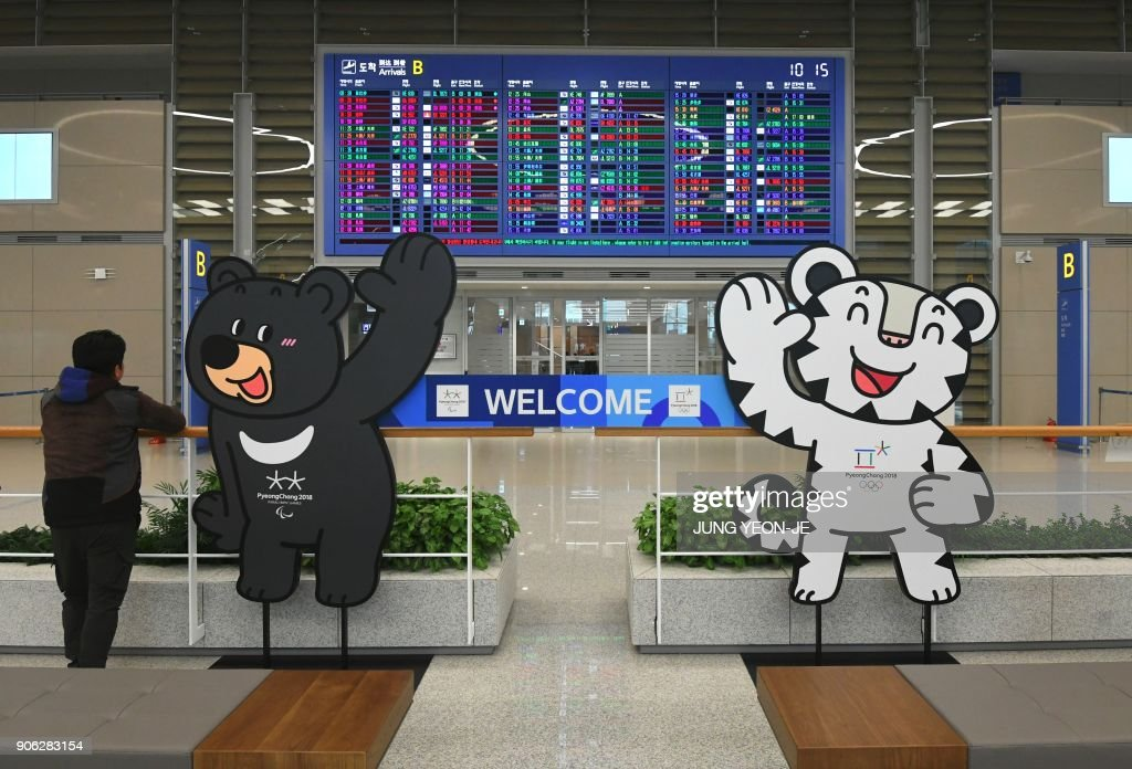 The mascots of the 2018 PyeongChang Winter Olympics are set at the arrival gate of Terminal 2 of Incheon International Airport, west of Seoul, on January 18, 2018. Incheon airport, South Korea's top gateway, on January 18 opened its second terminal, three weeks before the opening of the Pyeongchang Olympics, airport authorities said. Terminal 2 houses four airlines -- South Korea's flag carrier Korean Air, Air France, Delta, and KLM Royal Dutch Airlines.