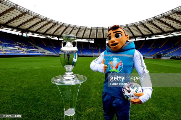 The Mascotte Skillzy poses with the trophy in Stadio Olimpico during the UEFA Euro 2020 Trophy Tour of Rome on April 20, 2021 in Rome, Italy.