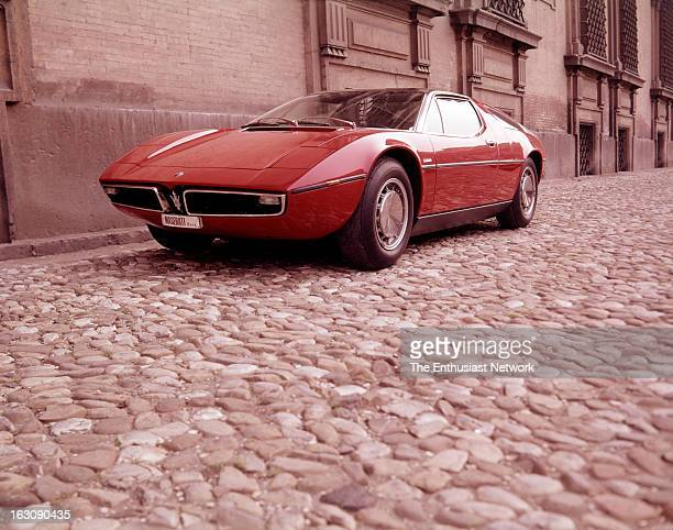 The Maserati Bora parked outside on the cobblestone streets by their Modena factory
