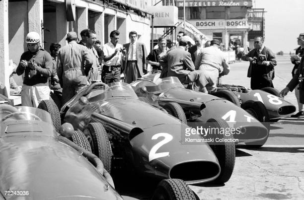 The Maserati lineup in the pit lane at the German Grand Prix, Nurburgring, 4th August 1957, Jean Behra stands at the left.