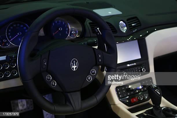 The Maserati logo is displayed on the steering wheel of a Fiat SpA Maserati GranTurismo at the Seoul Auto Salon 2013 in Seoul South Korea on Thursday...