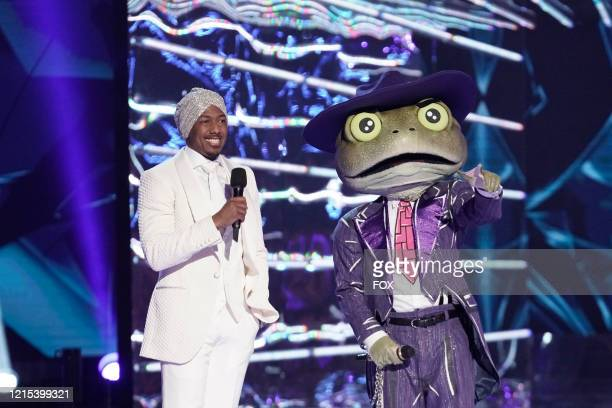 LR Host Nick Cannon and The Frog in the allnew Couldnt Mask For Anything More The Grand Finale season finale episode of THE MASKED SINGER airing...