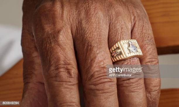 The Mason ring on the finger of a mason in a temple in Havana on June 27 2017 Founded officially in 1859 Cuba's Grand Lodge passed through many...