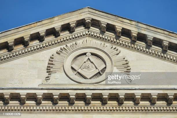 The Masonic Square and Compasses and Eye of Providence on the facade of Grand Lodge of Freemasons of Ireland in Dublin On January 10 in Dublin Ireland