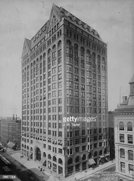 The Masonic Temple Chicago containing shops on the first nine floors surrounding a courtyard with offices above Designed by Burnham and Root it was...