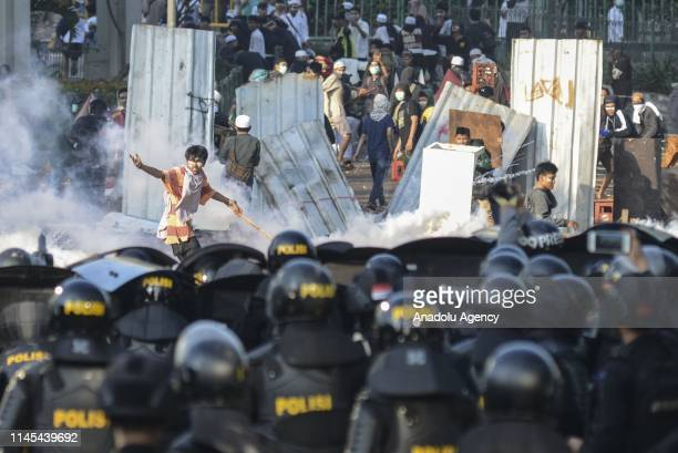 The mass involved in clashes with police forces in Tanah Abang wholesale market Jakarta Indonesia on Wednesday May 22 2019 This clash triggered...