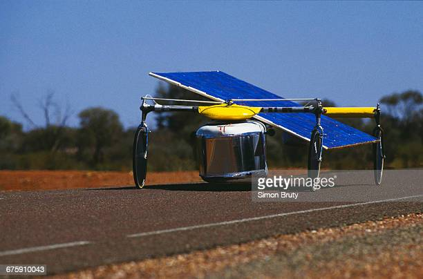 The Massachusetts Institute of Technology solarpowered car Star with its tilting solar panels drives on Stuart Highway during the inaugural Darwin to...