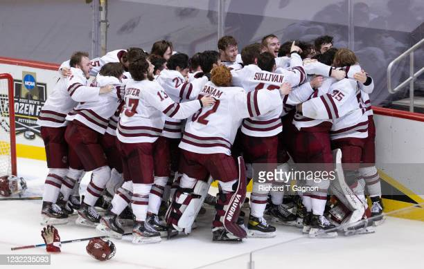The Massachusetts Minutemen celebrate a 5-0 victory against the St. Cloud State Huskies capturing their first NCAA hockey championship in school...