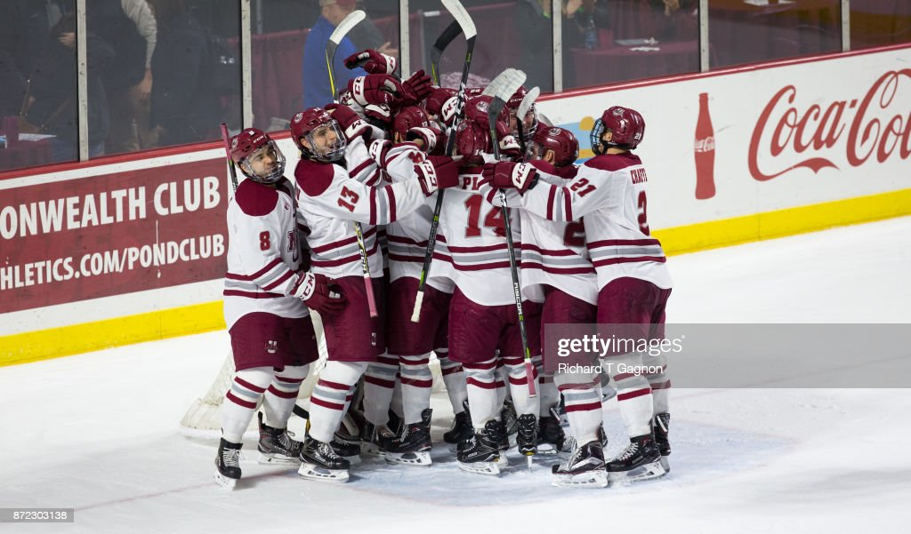 The Massachusetts Minutemen celebrate a victory against the Providence College Friars during NCAA hockey at the Mullins Center on November 9, 2017 in Amherst, Massachusetts. Massachusetts won 5-2.