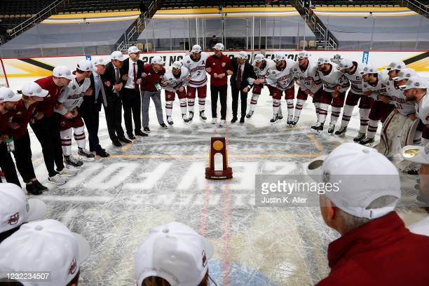 The Massachusetts Minutemen celebrate after defeating the St. Cloud State Huskies 5-0 during the Division I Men's Ice Hockey Championship held at PPG...