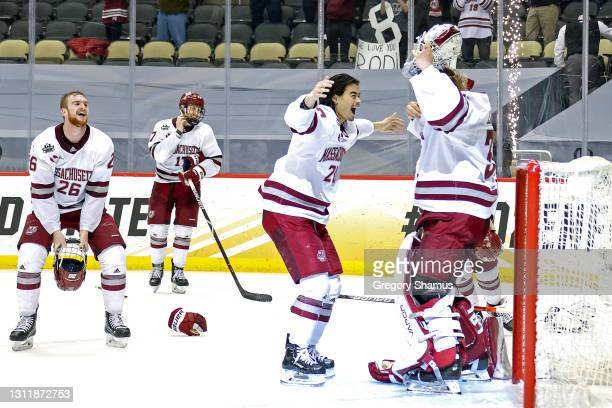 The Massachusetts Minutemen celebrate after winning the Division I Men's Ice Hockey Championship 5-0 against the St. Cloud St. Huskies at PPG Paints...