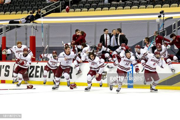 The Massachusetts Minutemen celebrates during after winning the Division I Men's Ice Hockey Championship 5-0 against the St. Cloud St. Huskies at PPG...