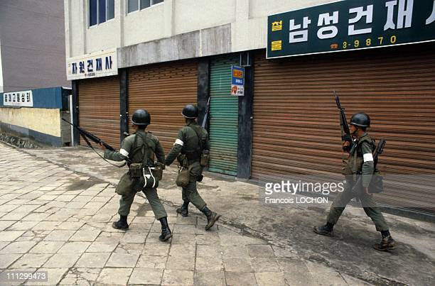 The massacre in Kwangju in which lots of people most of them young students were killed and many more injured tortured imprisoned by the South Korean...