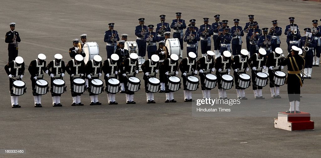 The massed bands from the three Defence forces perform during the Beating Retreat ceremony at Vijay Chowk on January 29, 2013 in New Delhi, India. This ceremony officially marks the end of Republic Day celebrations.