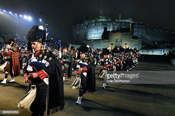 The massed pipes and drums emerge from the Castle at the preview night of the 53rd Edinburgh Military Tattoo the annual military pageant which takes...