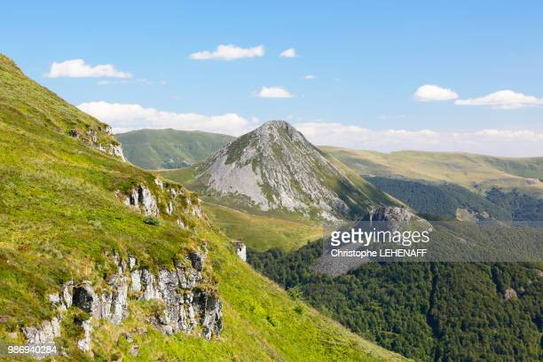 the massif central. cantal. view puy griou from the southeast side of puy mary. - auvergne stock pictures, royalty-free photos & images