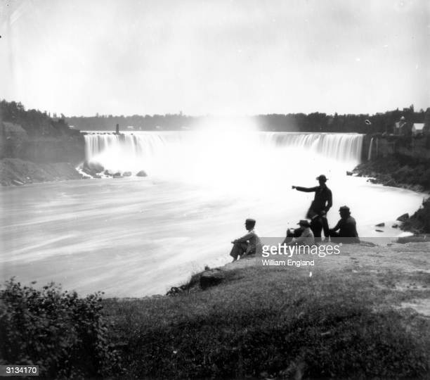 The massive cataract of the Canadian or Horseshoe Falls, the larger part of Niagara Falls. The observation point of Terrapin Tower can be seen to the...
