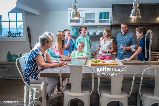 The massive kitchen island serves as a focal point for the family The Eager Family from left Carol and the elder Bill Annie Jack Cole Liam Katie Bill...