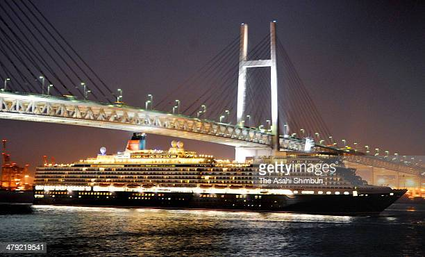 The massive luxury ocean liner the Queen Elizabeth passes under the Yokohama Bay Bridge on march 16 2014 in Yokohama Kanagawa Japan The cruise ship...