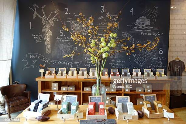 The Mast Brothers Chocolate factory retail customer display with bouquet. Chocolates for sale and tasting are displayed along with the blackboard...